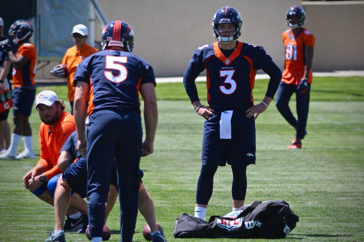 Broncos quarterbacks work during OTAs.