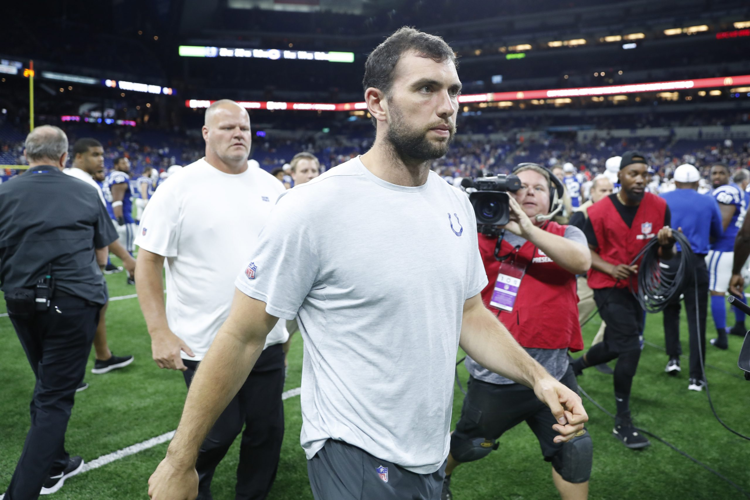 Aug 24, 2019; Indianapolis, IN, USA; Indianapolis Colts quarterback Andrew Luck walks off the field after the game against the Chicago Bears at Lucas Oil Stadium. Mandatory Credit: Brian Spurlock-USA TODAY Sports