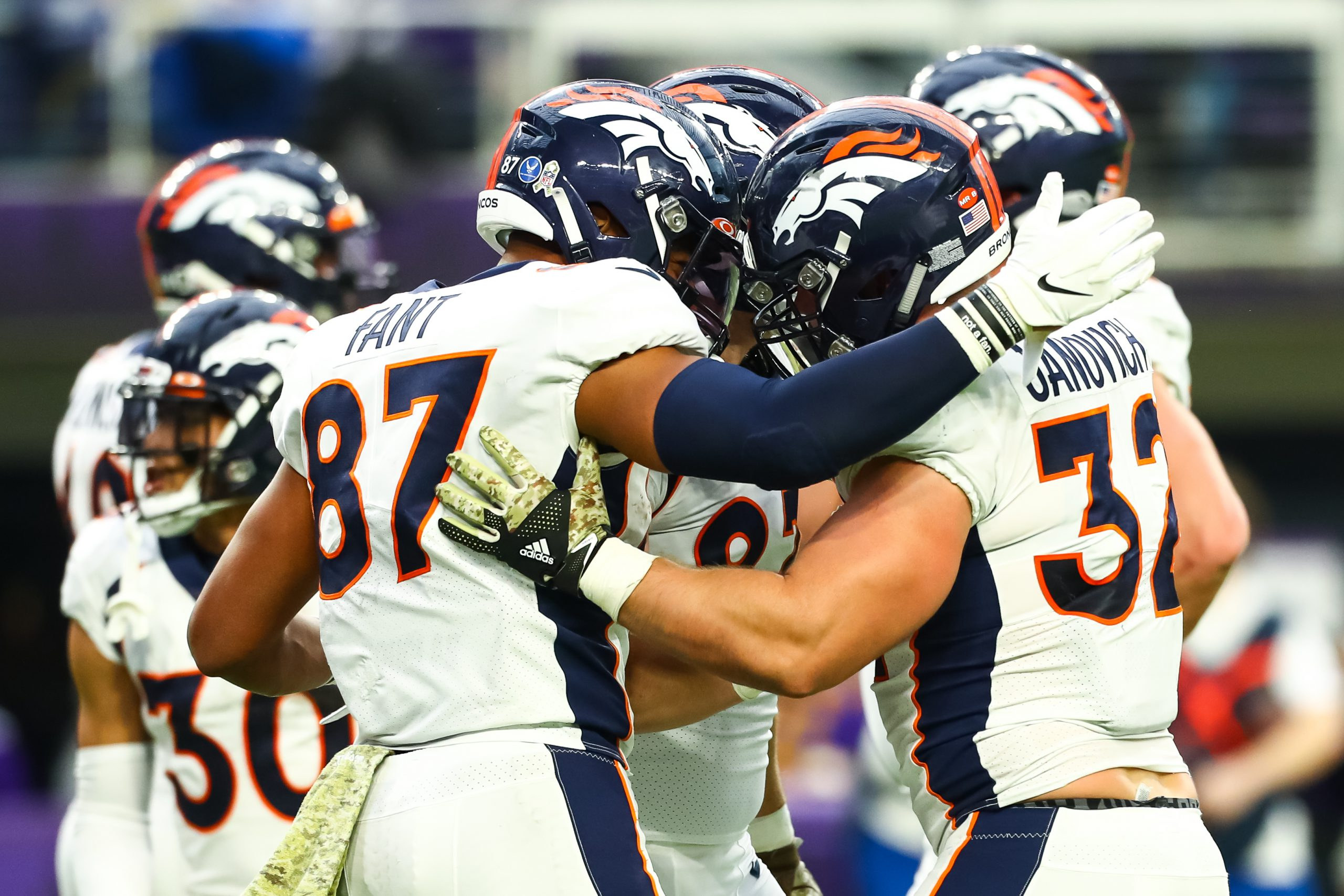 Nov 17, 2019; Minneapolis, MN, USA; Denver Broncos tight end Noah Fant (87) celebrates with fullback Andy Janovich (32) after Janovich scored a touchdown in the first quarter against the Minnesota Vikings at U.S. Bank Stadium. Mandatory Credit: David Berding-USA TODAY Sports