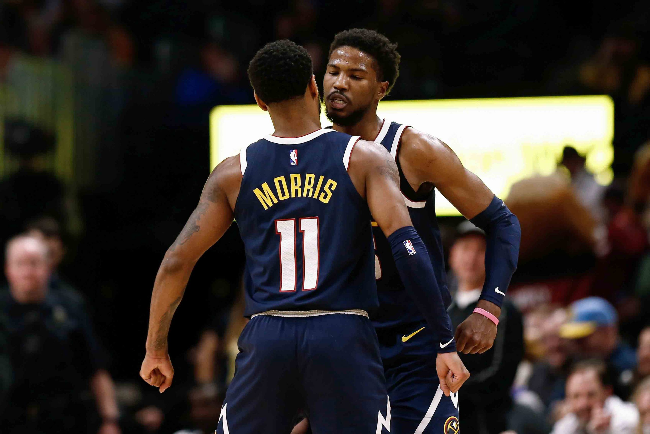 Nov 24, 2019; Denver, CO, USA; Denver Nuggets guard Malik Beasley (25) celebrates with guard Monte Morris (11) after a play in the fourth quarter against the Phoenix Suns at the Pepsi Center. Mandatory Credit: Isaiah J. Downing-USA TODAY Sports