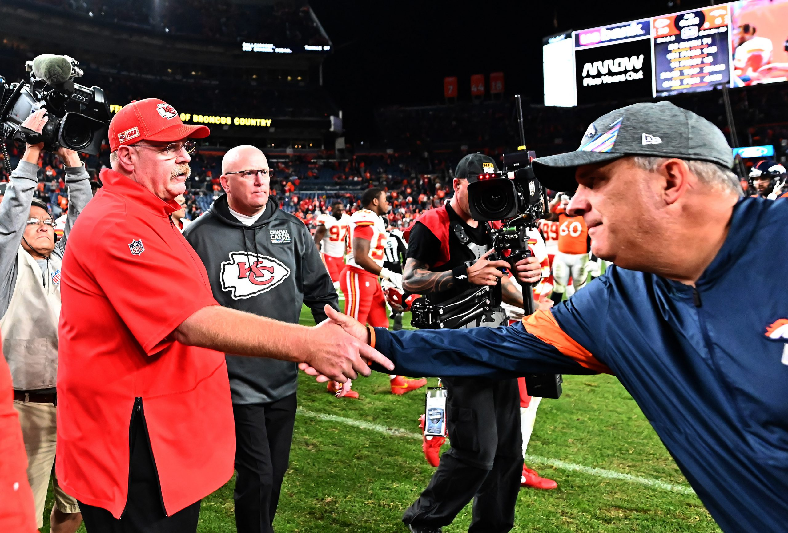 Oct 17, 2019; Denver, CO, USA; Kansas City Chiefs head coach Andy Reid and Denver Broncos head coach Vic Fangio following the game at Empower Field at Mile High. Mandatory Credit: Ron Chenoy-USA TODAY Sports